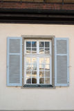 Window opposite Palace of the Solitude. Window reflecting the rococo style Palace of the Solitude in Stuttgart, Germany was built as summer residence between Stock Photos