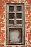 Window in an orange brick wall Royalty Free Stock Images
