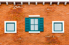 Window on the orange brick wall Stock Image
