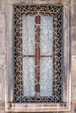 Window with ornamented metal lattice on a stone building Royalty Free Stock Images