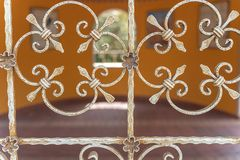 Window with ornate metal bars stock image