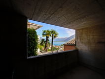 Window out of a underground car park built in mountain. Stock Photos