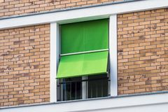 Window with outdoor sunblinds , fabric blinds on window exterior. Window with outdoor sunblinds - fabric blinds on window exterior Stock Images