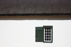 Window. Over the white wall Royalty Free Stock Photo