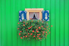 Window with painted shutters and flower box Stock Images
