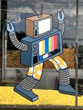 Window Painting of Robot made of TVs Royalty Free Stock Photography