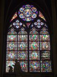 Window-pane from Notre-Dame in Paris. And the statue Royalty Free Stock Photography