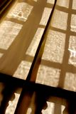 Window pane shadows on a curtain. A picture of  window pane shadows on a curtain in paris france Royalty Free Stock Images