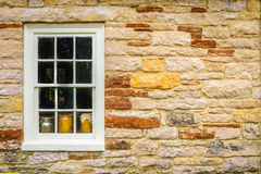 Window into the past. Window showing pottery in a stone wall royalty free stock photos