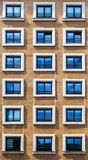 Window Pattern on a Brown Facade Stock Photography