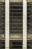 Window pattern detail of an old building facade. Vertical close up Royalty Free Stock Photography