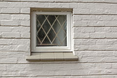 Window Patterns and Texture of Cement Covered Brick Wall Stock Photos