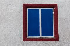 Window in pebble dashed wall Stock Photography