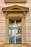 Window with pediment in Prague, Czech Republic. Classical colorful window with pediment in Prague, Czech Republic Stock Images