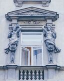 Window pediment with sculptures