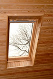 Window on a penthouse of the wooden house. Interior Royalty Free Stock Photo