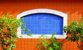 the orange and blue brickwindow royalty free stock photography