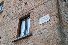 Window in the Piazza dei Priori in Volterra. Italy Tuscany Pisa Volterra Piazza dei Priori Stock Photos