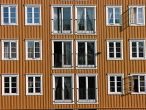 Window pilework. Orange/brown Window pilework over a canal Royalty Free Stock Images