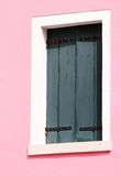 Window on a pink wall of the House on the island of Burano in It Stock Images