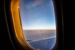 Window of the plane, covered with frost.  Royalty Free Stock Photos