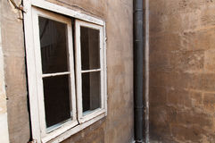 Window and plastered wall. A window of the old building in Bordeaux Royalty Free Stock Photography