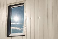 Window in plastic siding wall Royalty Free Stock Photography