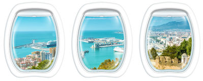 Window on port of Malaga. Three plane windows on port of Malaga from the Gibralfaro Castle, Andalusia, Spain, from a plane on the porthole windows. Copy space Royalty Free Stock Images