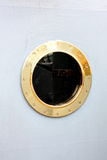 Window - the porthole at a military ship. Window - the Antique Bronze porthole at a old russian military ship Royalty Free Stock Images