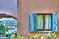 Window in Porto Rotondo. Turquoise window in Porto Rotondo, Sardinia royalty free stock photos