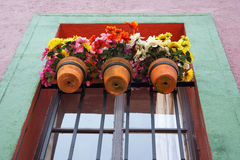 Window with pots Royalty Free Stock Image