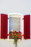 Window with pretty flower arrangement Royalty Free Stock Photography