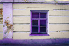 Window with purple frame stock photography