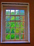Window, Quarrybank Mill, UK. These photographs explore the theme of windows as a portal between two worlds , that of the outside and that of the inside. The Stock Photography