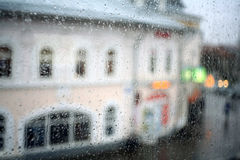 Window rain blurred city Stock Photography