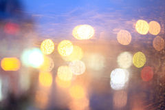 Window rain blurred city lights Royalty Free Stock Photography