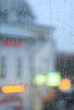 Window rain blurred city lights Royalty Free Stock Photo