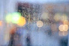 Window rain blurred city lights Royalty Free Stock Image