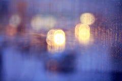 Window rain blurred city lights Stock Photos