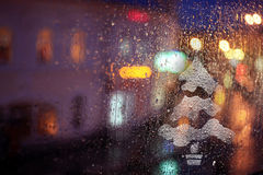 Window rain blurred city lights Stock Photography
