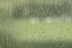 Window with rain drops in green color Stock Photos