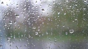 Window rain speed train road. Close up of window glass with rain drops high speed train stock video