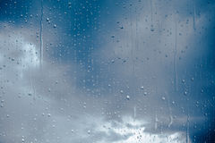Window raindrops. Rain drops on a window, close-up Stock Image