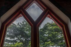 The window that receives light is inside the Thai temple church. Sunlight through the church window stock image