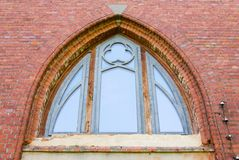 Window of red brick building. Arched window of a red brick building Stock Photo