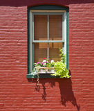 Window in red Brick wall Stock Photography