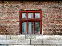 Window in a red brick wall Stock Photography