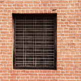 Window and red brick wall Stock Photography