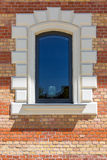 Window in a red brick wall Stock Images