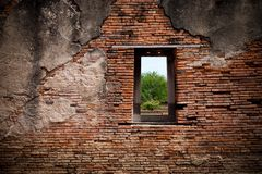 A window on the red brick wall Stock Photography